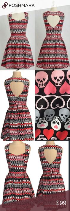 Skull and heart dress Hearts & Skulls Dress with cut out back detail.  100% cotton  Made in USA  SIZE         TOTAL LENGTH  S                       Sold out  M                      36  L                        sold out  XL                      38 Dresses