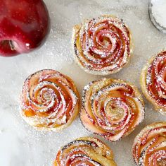 Impress your guests with this beautiful rose-shaped dessert made with lots of soft and delicious apple slices, wrapped in sweet and crispy puff pastry Cooking with Manuela: Apple Roses Apple Desserts, Delicious Desserts, Yummy Food, Pastry Recipes, Dessert Recipes, Cooking Recipes, Easy Cooking, Apple Rose Tart, Apple Pie