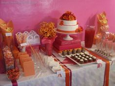 Pink and Orange Dessert Table by Simply Sweet Designs at Martha Stewart Dreamers into Doers