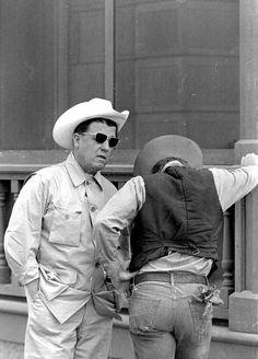thelittlefreakazoidthatcould: Director George Stevens and James Dean photographed by Allan Grant, on the set of Giant, Texas, 1955.