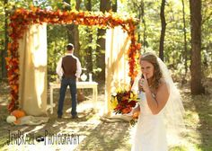 Jen Brazil Photography, from Cathryn + Tyler's wedding at The Barn. Sunflower yellow, Razorback red, burnt orange and chocolate brown, with plenty of burlap accents, fall leaves and pumpkins.