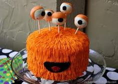 kids monster party cake pop eyeballs...take the cake pops off the stick and this would be a super cute smash cake!