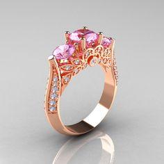 Classic 14K Rose Gold Three Stone Diamond Light Pink Sapphire Solitaire Ring R200-14KRGDLPS. $1,359.00, via Etsy.