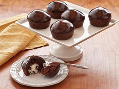 Your guests will be pleasantly surprised when they bite into these chocolate-frosted cupcakes.