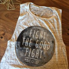 """Final Sale Price // Originally $36 Each tank purchased means a child in need will receive 7 meals! HALF UNITED has provided over 500,000 meals (to date) for children in need, together we are fighting the good fight!  Wear your FTGF tank on a warm day or layer it when it gets cold.  However you wear it, do so proudly knowing that you have provided 7 meals for a child in need!  91% polyester, 9% cotton tank top cut artwork designed by Savannah Watson of """"Merewif Jewelry"""" available in S-XL…"""