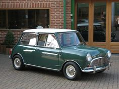 Austin Mini Cooper 'S' 1275 Mark 1 Left Hand Drive. Almond Green with Old English White Roof/Porcelain Green and Grey Trim. Mini Cooper S, Cooper Car, Vintage Sports Cars, British Sports Cars, Vintage Cars, Classic Mini, Classic Cars, Austin Cars, Classic Motors