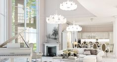 Дизайн совмещенной кухни-гостиной с барной стойкой: 75 мультифункциональных и современных интерьеров http://happymodern.ru/dizajn-kuxni-sovmeshhennoj-s-gostinoj-foto-s-barnoi-stoikoj/ Роскошная кухня-гостинная арт-деко: обеденная группа, мягкая часть с журнальным столиком, белый рояль и камин, люстры
