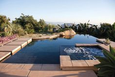 This contemporary infinity pool uses cubes of travertine to form its back edge. Lined with Forest Pebble Tec® and Oceanside Glasstile® at the waterline, the pool defines well-designed elegance. Questar Pools and Spas, Escondido, California. Photography courtesy of Allen Carrasco http://www.luxurypools.com/builders-designers/questar-pools-and-spas-inc.aspx