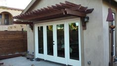 Cedar Pergola Built Between House And Garage Designed