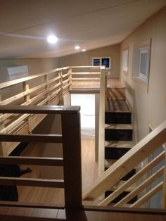 another intriguing catwalk rest of the tiny house is nice but having 2 full sets of stairs takes up a lot of space the couch is right in front of - Tiny House With Loft 2