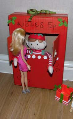 An Elf as cute as this one could charge far more than 5p for his kisses! This enterprising fellow has set up his own kissing booth. Pucker up! Find more funny Elf ideas at elfforchristmas.com