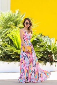 If you're feeling a little bold, a printed maxi dress like this one on Kim of Lace and Locks is a great option for a summer wedding.