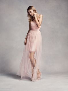 A blush pink bridesmaid dress with a long sheer overlay by White x Vera Wang is the perfect way for a bridesmaid to continue the wedding color scheme of the bride. | Wedding advice and inspiration from Vera Wang