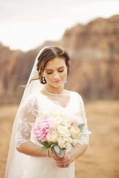 modest wedding dress with tight bodice and half sleeve from alta moda. --(modest bridal gown)--