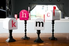 Surprise your kids, a friend or a co-worker with individual mailbox. Buy inexpensive little mailboxes (Target) and inexpensive candlesticks painted black. Attach the mailbox to the candlestick (I suppose you hot glue them) and attach a self-adhesive letter to the front. Place a little 'love note' inside, along with candy, movie tickets, ice cream coupons, etc... Simple, easy and adorable.