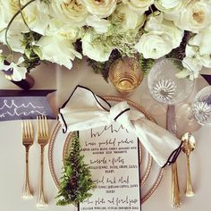 White and Gold Color Palette: This elegant holiday place setting is a great medium between modern and traditional. The white and gold play beautifully off of each other, but the tiny accents of black and greenery brings the whole place setting up to date. | 9 Holiday Place Settings by Color Palette
