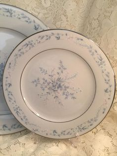 Contemporary Fine China by Noritake (Sri Lanka) Carolyn Pattern 2693 Discontinued. Blue/Green Flowers On Rim, Platinum Trim. Circa 1973-1984. I have a matching 10.25 dinner plate and 8.25 salad plate. These plates are in excellent condition.