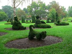 The Topiary Park of Columbus -  Old Deaf School Park Columbus, OH 43215   The art park is a recreation in topiary of  A Sunday Afternoon of the Isle of La Grande Jatte, by Georges Seurat. The only topiary interpretation of a painting in existence. The landscape consists of 50 topiary people, 8 boats, 3 dogs, a monkey, a cat, a real pond and trees.  The park is FREE and open year-round from dawn to dusk. XPARK