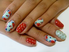 Mint green nails with red floral decals, red solid pinkie accent nails with gold bouillon caviar, flowers, Nail art