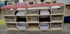 Try symmetry for neater storage in your classroom. Beth Lawson's containers vary, but because the pattern of materials is replicated across the unit, everything looks tidy.