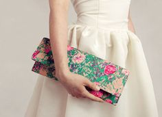 I like how the white dress against the white background really makes the bag pop!
