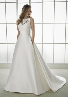 We offer a large selection of brand name bridal gowns from trendy designers such as Pronovias, Allure, and others. Our wedding dresses cater to any taste and budget. Long Wedding Dresses, Bridal Dresses, Wedding Gowns, Satin Duchesse, Dream Wedding, Wedding Day, Illusion Neckline, Bateau Neckline, Lace Bodice