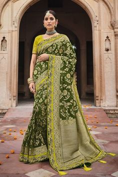 Mehendi green colour silk traditional saree with a matching lime green silk blouse. #banarasisarees #banarasisareelookforwedding #banarasisareeblousedesign #banarasisilksaree #banarasisareeblousedesignslatest #sareestyles #saree #sareewedding #sareegown #sareedesignspartywear #indianweddingoutfits #indianfashion #indiandesignerwear #indianbridalfashion #weddingdresses #wedding #bridalblousedesigns Latest Sarees Online, Designer Sarees Online, Trendy Sarees, Stylish Sarees, Art Silk Sarees, Banarasi Sarees, Green Saree, Black Saree, Saree Trends