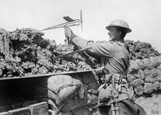 Western Front: Australian uses a wind direction indicator to assess likehood of a gas attack. via  WWI covered live
