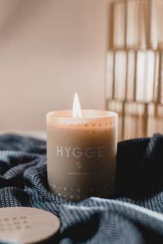 The Hygge Candle by Skandinavisk is a simple way to inspire hygge in your home. Featuring delicate n