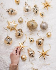 """""""When decorating a tree, I like to use a variety of shapes and sizes of ornaments in a cohesive colour story to keep the look polished. Hints of glitter add just the right amount of shine. Tree Decorations, Christmas Decorations, Holiday Decorating, Decorating Ideas, Colour Story, Color, Xmas Baubles, Christmas Holidays, Christmas Stuff"""