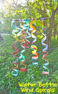 Try this easy water bottle craft for some outside fun. It's great fun for all ages. These colorful Wind Spirals are pretty to hang in the sun.