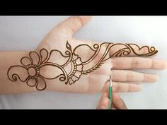 What is a Henna Tattoo? Henna tattoos are becoming very popular, but what precisely are they? Henna Hand Designs, Very Simple Mehndi Designs, Mehndi Designs Finger, Henna Tattoo Designs Simple, Latest Arabic Mehndi Designs, Mehndi Designs Book, Mehndi Designs For Girls, Stylish Mehndi Designs, Mehndi Designs For Beginners