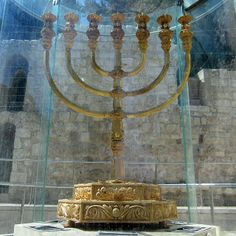 The Golden Menorah of Jerusalem: the menorah (Lamp Stand) is the true symbol of Israel. The Star of David was added by man.