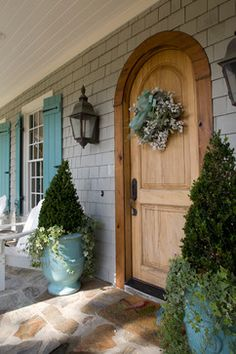 Ahhh love the door the aqua shutters everything about this is perfection!!!