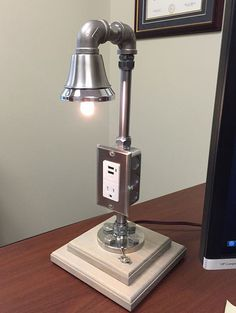 Industrial Desk Lamp - Custom Made Stainless Steel lighting fixture with electrical outlet and USB charging capabilities