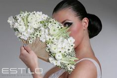 Fresh flowers attached to fan for a unique choice in bridal bouquet