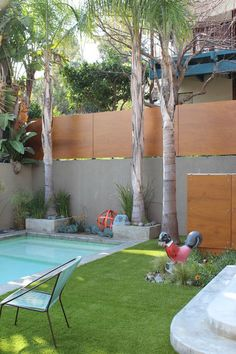 """""""Solid wood panels give this fence a distinctly modern touch. Added on top of a poured concrete wall, they create extra privacy and put the smooth wood grain on full display.""""---gorgeous! but I wonder about any maintenance or weathering issues--this is probably only plausible in a warm-year-round climate~"""