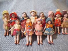Magnificent Mint All Bisque German Miniature Brightly Dressed Dolls Set of 12 | eBay