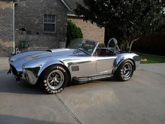 1966 Shelby Cobra 427 S/C Kirkham  Beautiful Kirkham Cobra in polished aluminum with brushed racing stripes.