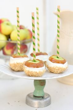 adorable mini Lady apples on striped wooden sticks {stamp?}, dipped in caramel, white chocolate and graham crackers/ground nuts