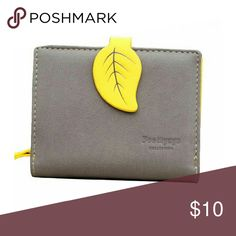 Grey and yellow vegan wallet. Small. Small vegan leather wallet. Used for about a day, it is more wallet than I need. Bags Wallets
