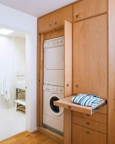 laundry/mud room.  Wow!  Love the idea of the pull out folding board.  Not sure if I'd use it.
