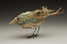 Animals made of wood, wire and pieces of fabric ...