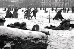 Soviet troops engage in a military exercises on Chistoprudny Boulevard in Moscow as civilians in the background look on. The soldiers in the foreground use PM M1910 (Maxim's machine gun model 1910) heavy machine guns. The tenacious Soviet defensive effort frustrated the Axis attack during the Battle of Moscow. Moscow was one of the primary military and political objectives for Axis forces in their invasion of the Soviet Union. Moscow, Russia, Soviet Union. December 1941. Image taken by…