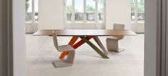 The legs of Big Table are made of laser-cut steel, painted matt in different colour combinations: coral red / orange / green / lilac, powder pink / brown / dove-grey / amaranth, or completely in...