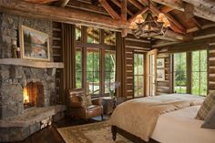 Log bedroom with stone fireplace