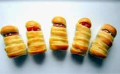 Mummies - quick dinner idea for Halloween night!  We did it and I let my some make them, it was cute.