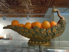 What an AWESOME pop of COLOR!  Bright orange oranges in a vintage bronze peacock bowl at The Tiffany Deli on Park Avenue in Winter Park, Florida.