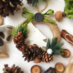 grapevine wreath with small sliver pine cones - Salvabrani Paper Christmas Decorations, Christmas Ornament Crafts, Christmas Wreaths, Christmas Crafts, Christmas Makes, Rustic Christmas, Simple Christmas, Christmas Holidays, Diy Christmas Videos