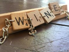 Your favorite word game up-cycled into an expressive bracelet!<br> It's 5 'o clock somewhere...celebrate with this bracelet created from upcycled natural wood Scrabble tiles accented by a fleur-de-lis